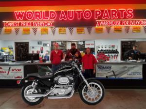 From left to right: Steve Bridge, World Auto Parts Lorain store manager; winner Dan Zimmerman and Amanda Dodge, World Auto Parts, counterperson.